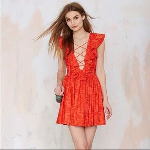 The Jetset Diaries coral lace up ruffle dress